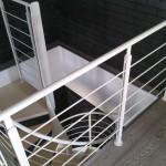 Scala a chiocciola con ringhiera in acciaio verniciato - Alfa Scale